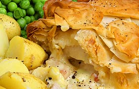 Succulent chicken and ham pie available at The REAL MEALS